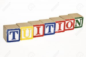 5358585-Wooden-blocks-laid-out-horizontally-spelling-out-tuition-Stock-Photo